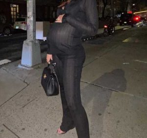 Pregnant Emily Ratajkowski Says She's 'Bout to Pop' While Showing Off Baby Bump on Nighttime Stroll