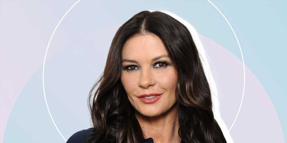 Catherine Zeta-Jones, 51, Shows Side-Boob in Backless Swimsuit While Doing Yoga on a Boat